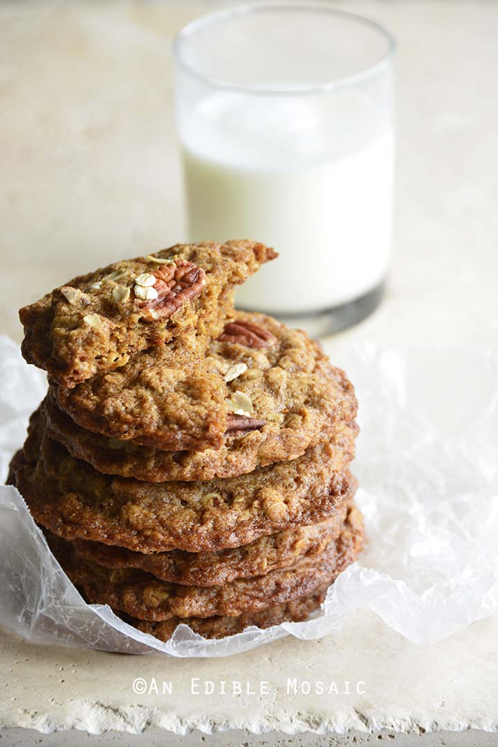 Stack of Chewy Cinnamon Pecan Brown Butter Oatmeal Cookies with Glass of Milk
