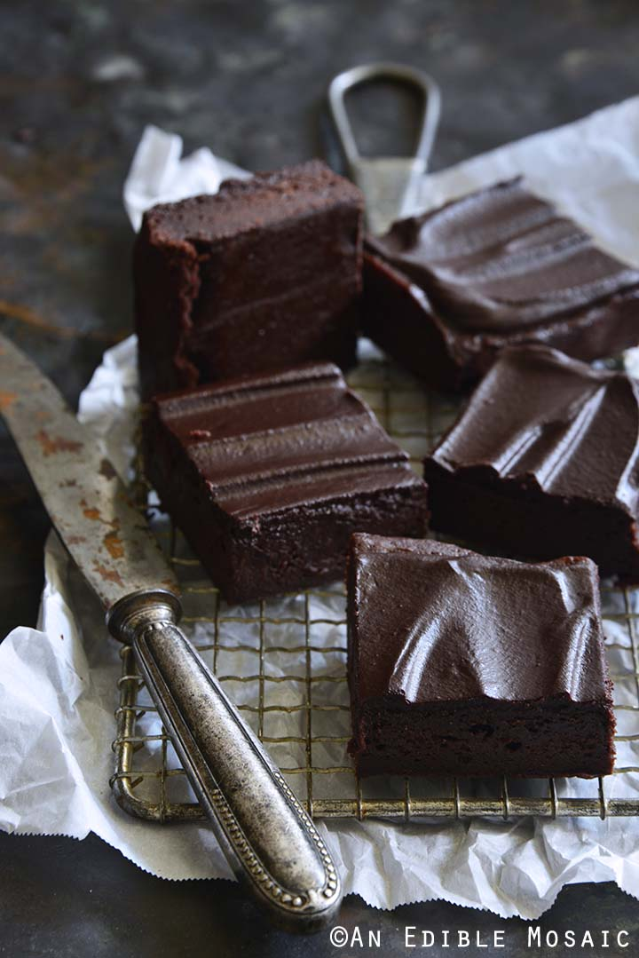 Fudgy Guinness Brownies with Dark Chocolate Ganache on Wire Rack