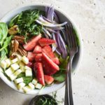 Overhead View of Spinach Strawberry Salad on Creamy Marble Background