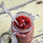 Jar of Sugar Free Strawberry Jam on Rustic Yellow Wooden Table