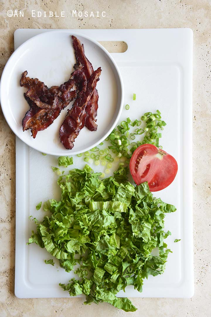 Bacon Lettuce Tomato Scallion on White Cutting Board