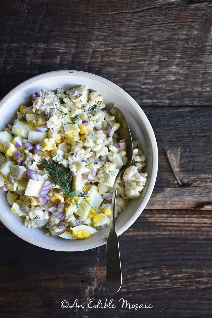 Cauliflower Potato Salad on Dark Wooden Board Overhead View
