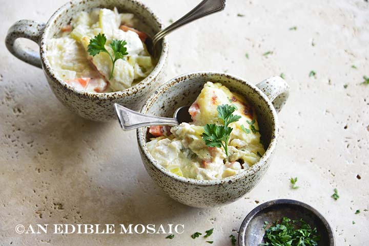 Two Ceramic Mugs with Low Carb Creamy Chicken Casserole Topped with Fresh Parsley
