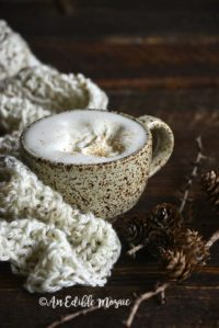 Front View of Eggnog Latte in Ceramic Mug with Cream Colored Scarf