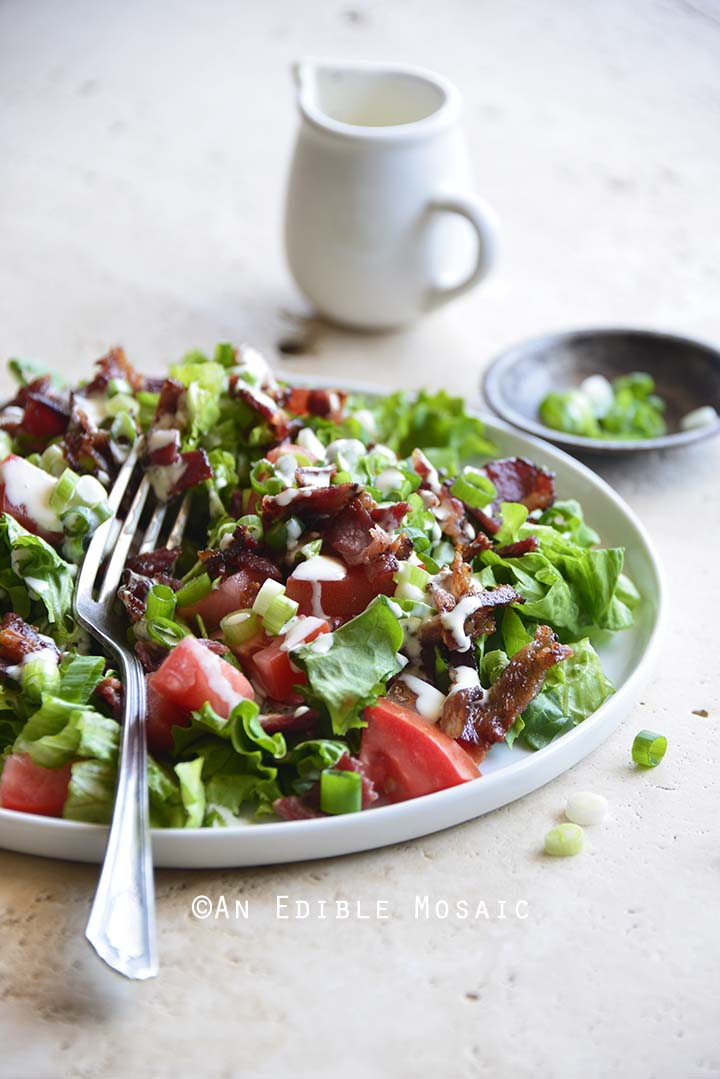 Front View of Bacon Lettuce Tomato Salad with Fork on Plate