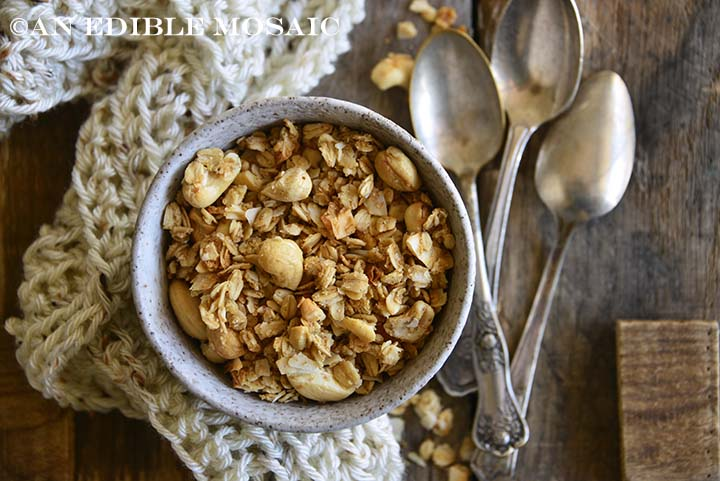 Overhead View of Healthy Granola Recipe with Cashews and Coconut with Vintage Spoons and Cozy Cream-Colored Scarf