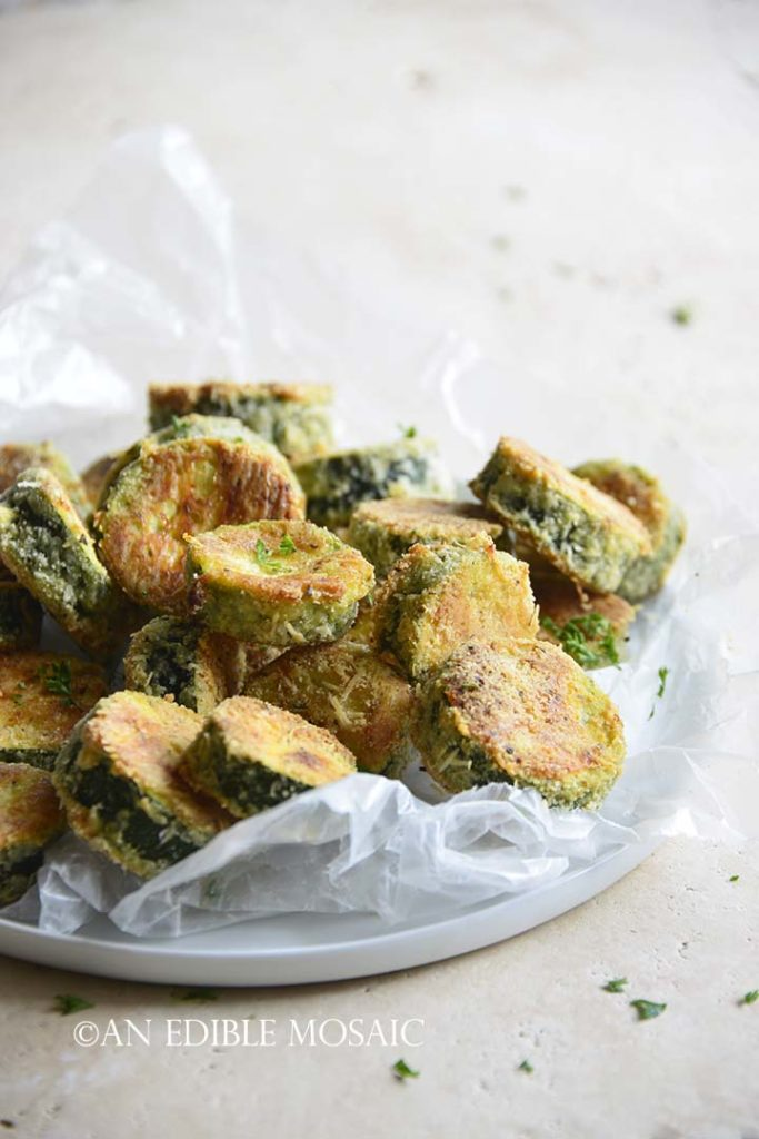 Front View of Keto Crispy Baked Zucchini Slices on White Plate