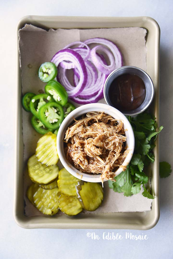 Instant Pot BBQ Chicken on Tray with Pickles Onion and Jalapeno Slices