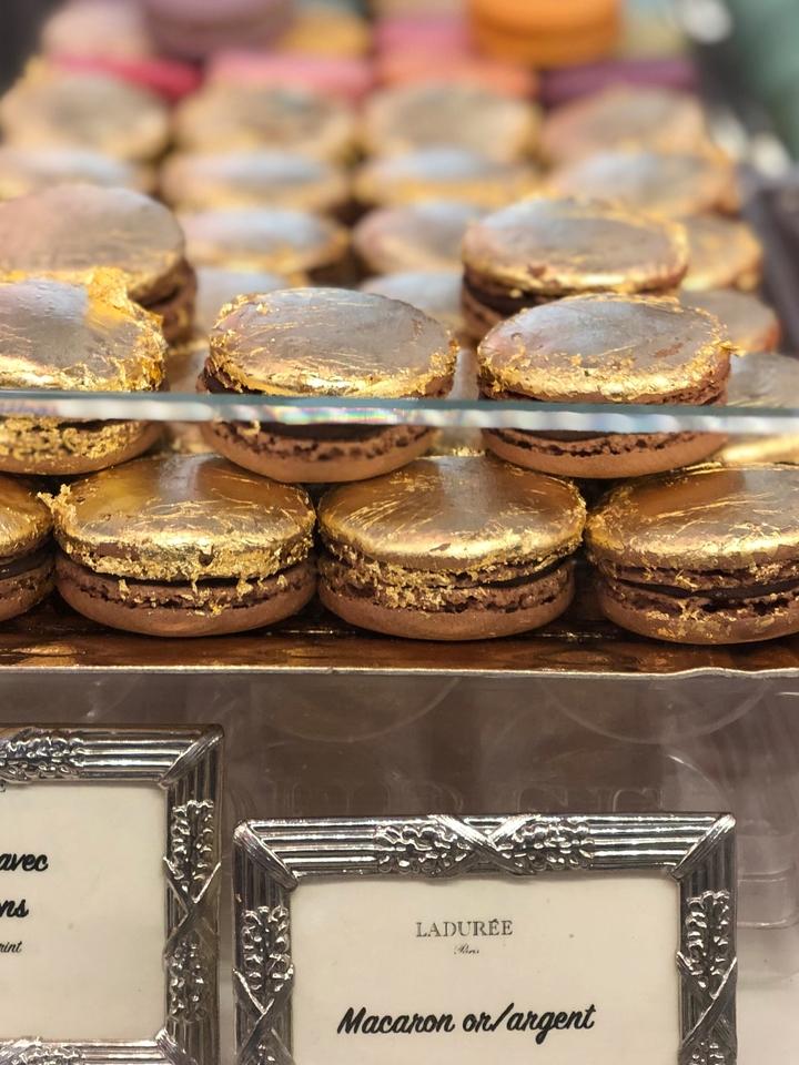 Pile of Gold Macarons at Laduree Paris