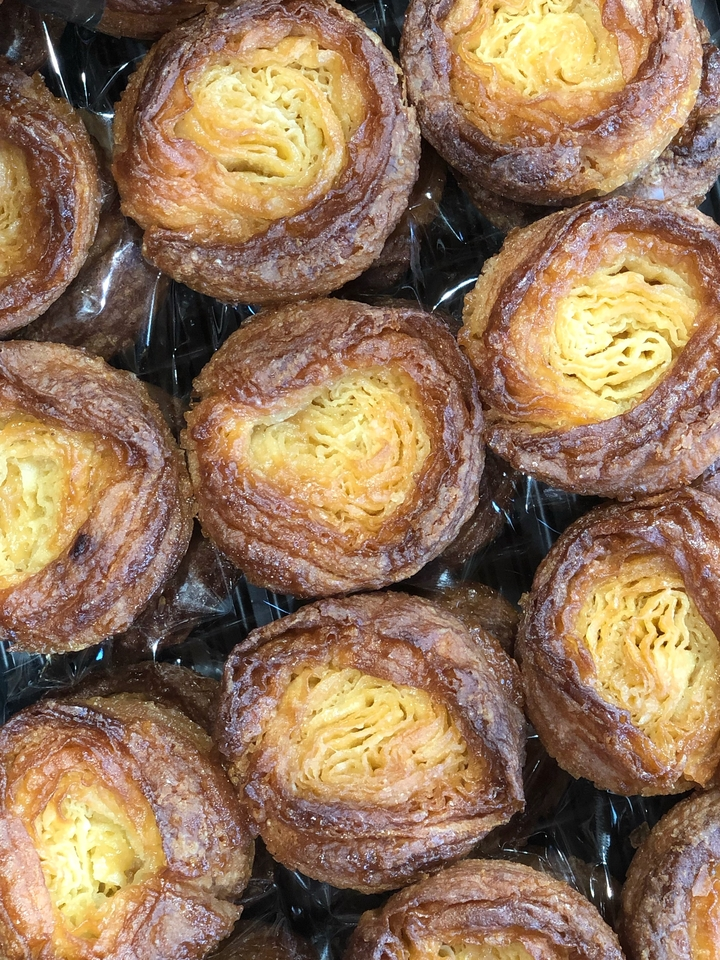 Close Up of Kouign Amann in Bakery Case