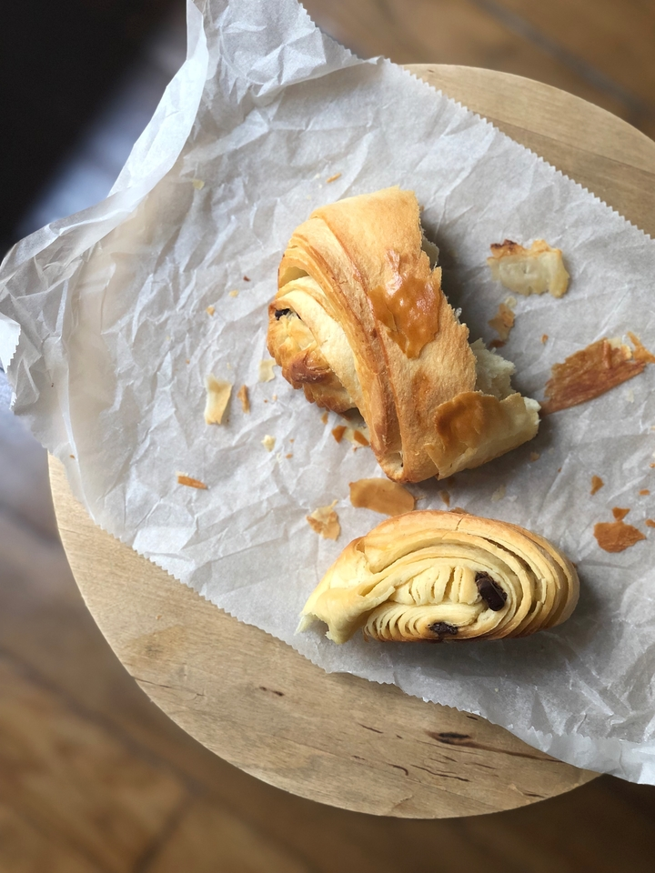 Pain au Chocolat on Parchment Paper on Wooden Table