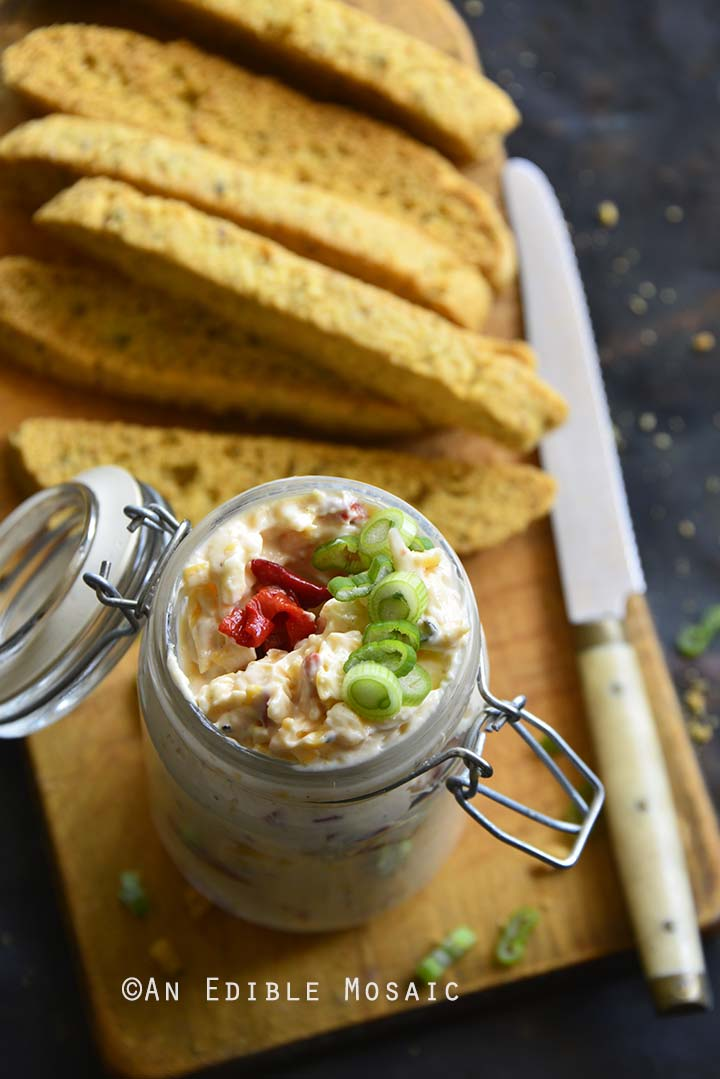 Pimento Cheese in Glass Jar on Wooden Board with Savory Keto Biscotti