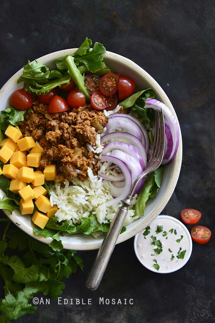 Turkey Taco Rice Salad Bowls with Creamy Tex-Mex Dressing in White Bowl on Dark Metal Background