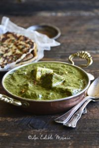 Palak Paneer Recipe (Indian Spinach Curry with Paneer Cheese) Close Up Front View on Wooden Table