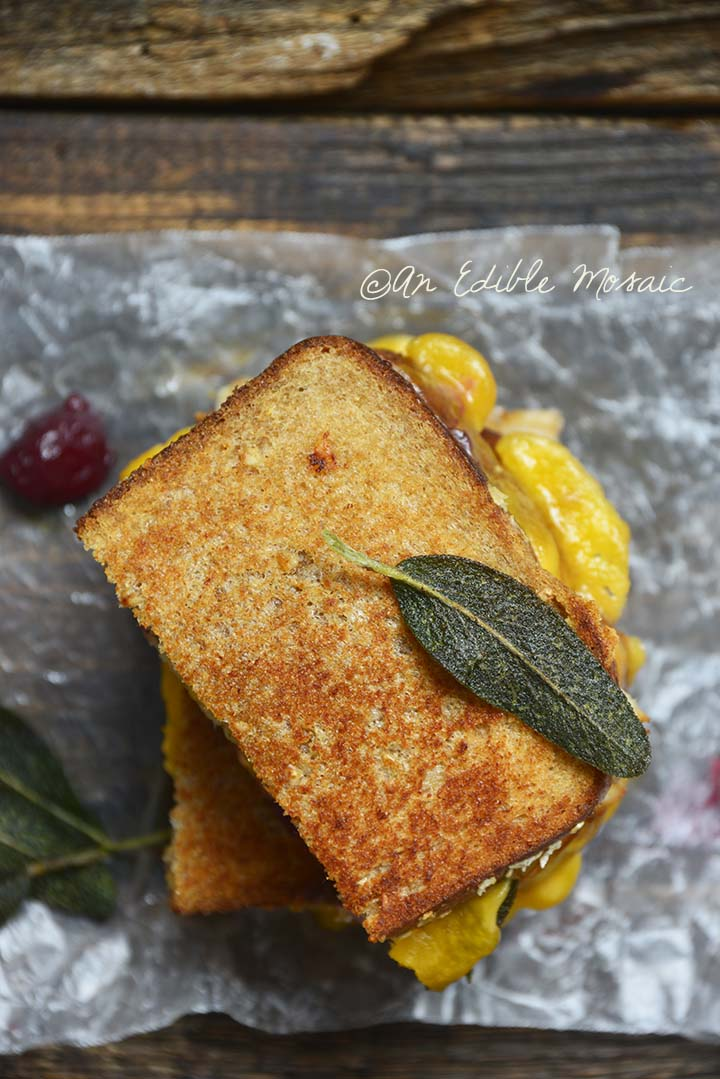 Top View of Grilled Cheese Thanksgiving Leftovers Sandwich Recipe with Fried Sage on Parchment Paper
