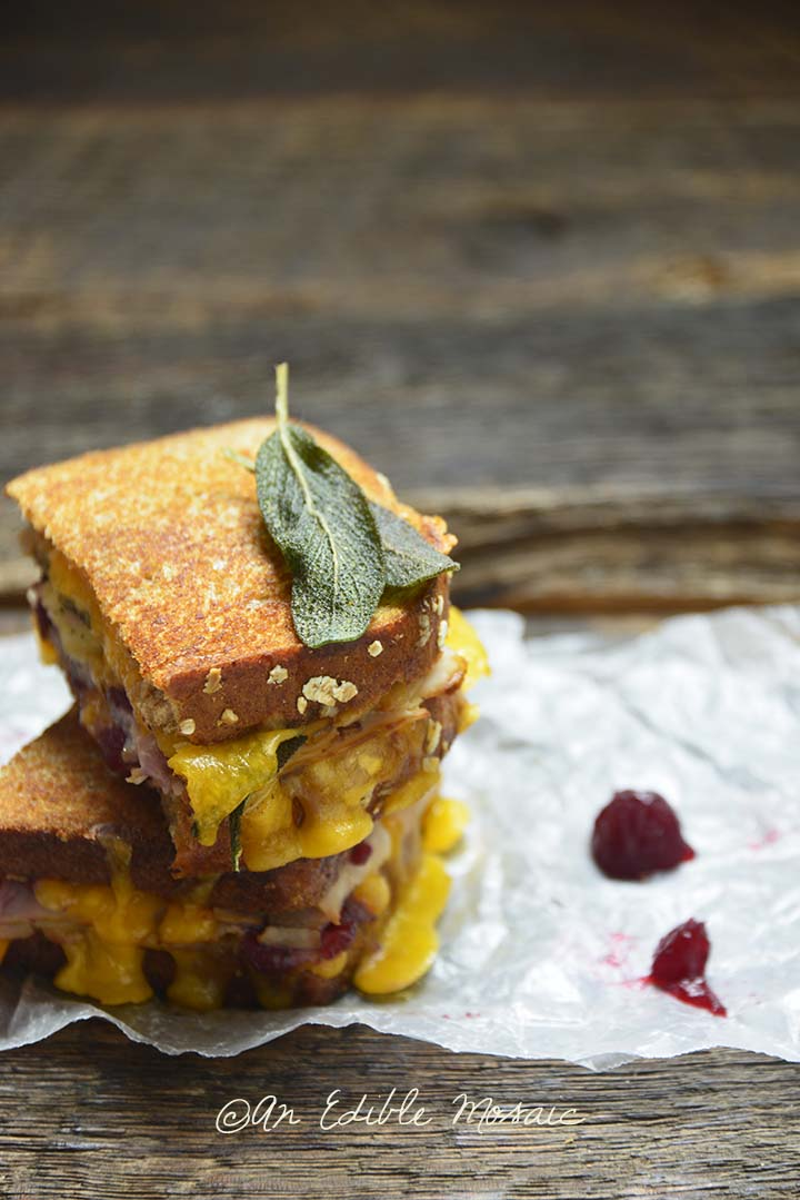 Stacked Grilled Cheese Turkey Cranberry Sandwich on Crinkled Parchment Paper