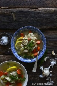 2 Bowls of Homemade Chicken Soup Recipe From Scratch on Dark Wooden Table