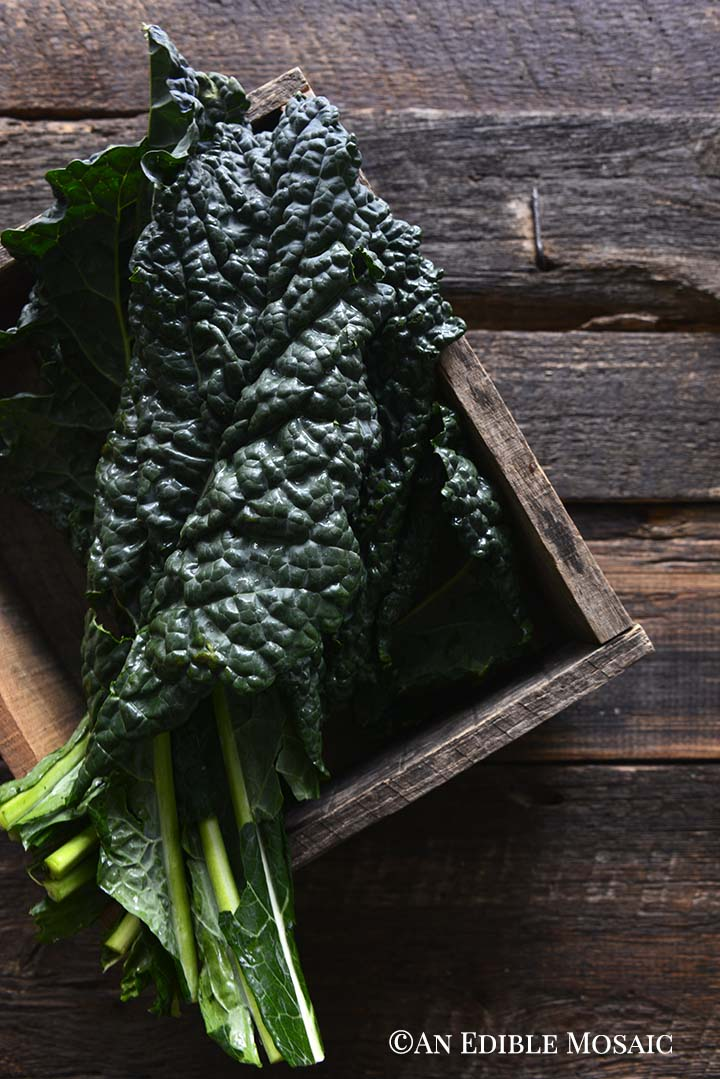 Lacinato Kale in Wooden Box on Dark Wood Table