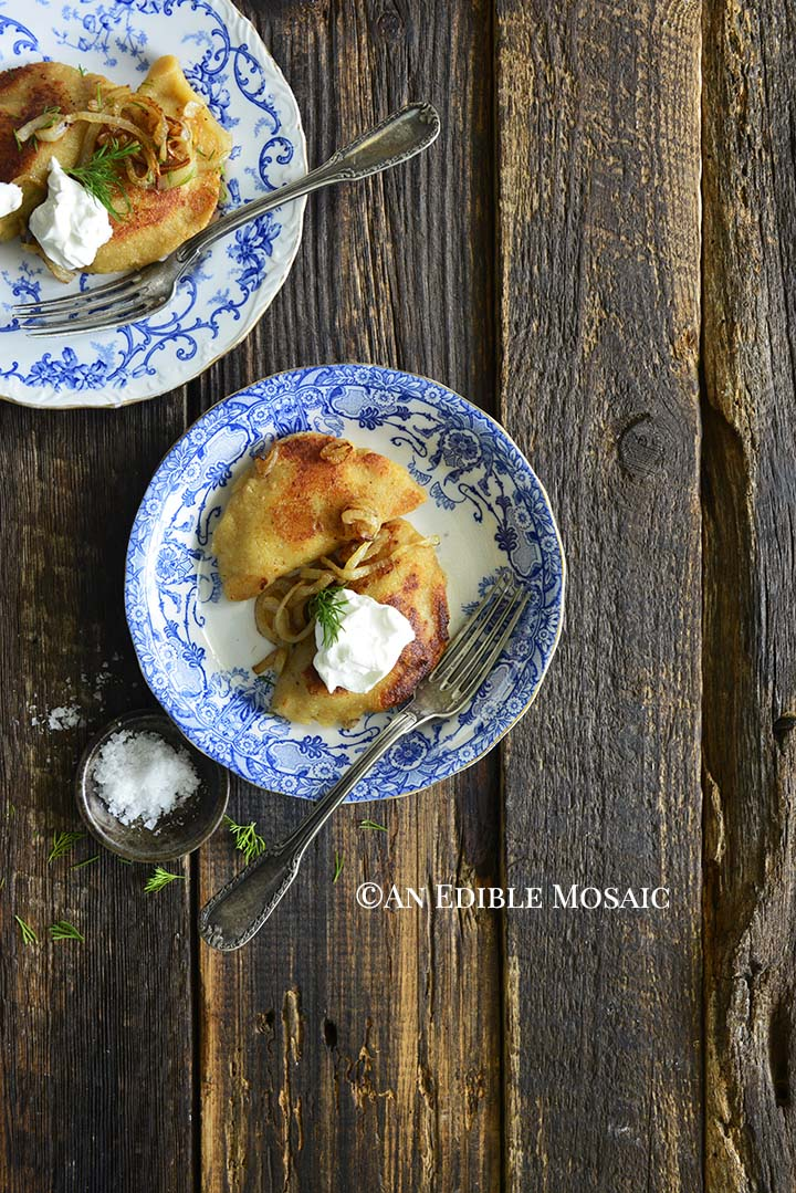 Keto Pierogi Recipe on Blue and White Flowered Plates on Dark Wooden Table