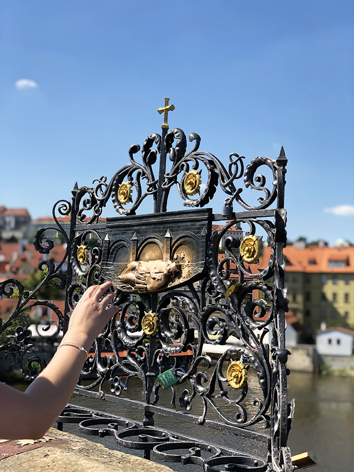 Touching Statues on Charles Bridge for Good Luck