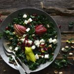Top View of Bowl of Winter Salad with Vintage Serving Spoons