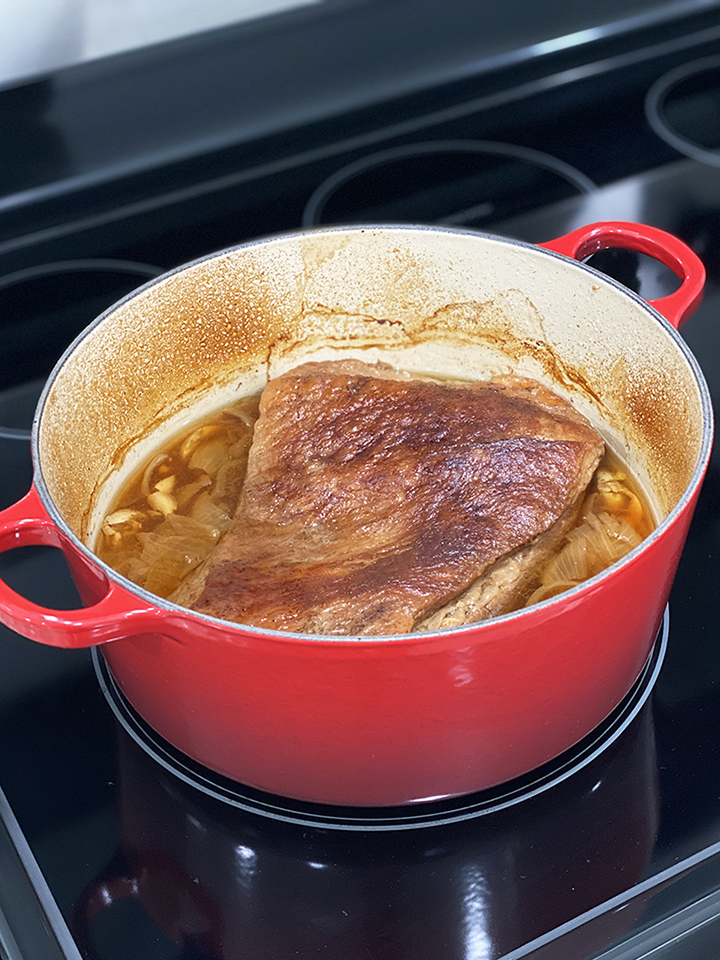 Braised Beef Brisket in Red Dutch Oven