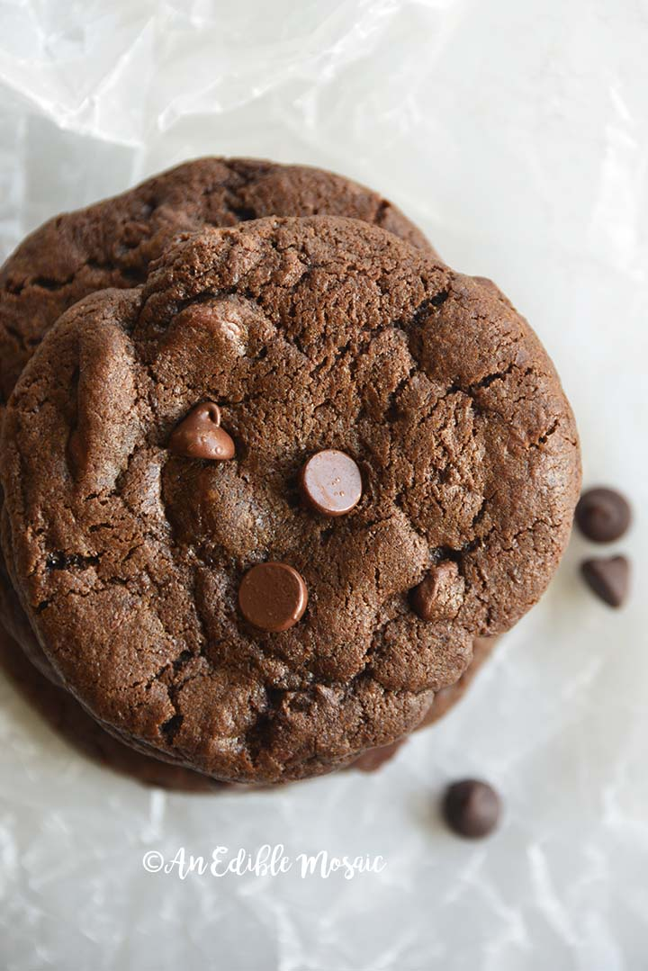 Close Up Top View of Double Chocolate Chip Cookies Recipe on White Wax Paper