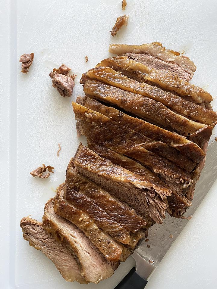 Slicing Beef Brisking on Cutting Board