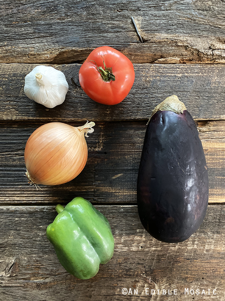 Afghan Eggplant Ingredients on Dark Wooden Table