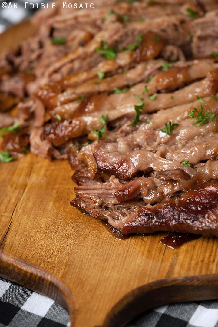 Front View of Sliced Beef Brisket on Wooden Cutting Board