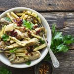 Creamy Mushroom Chicken Pasta in White Bowl with Vintage Fork