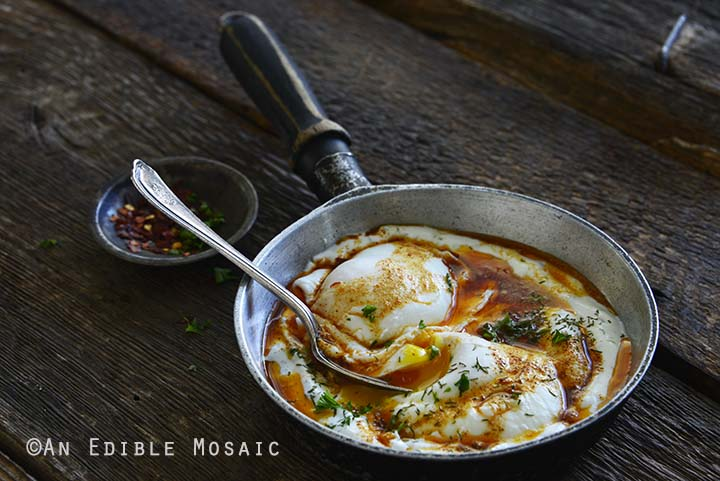 Front View of Turkish Poached Eggs with Garlicky Yogurt in Frying Pan