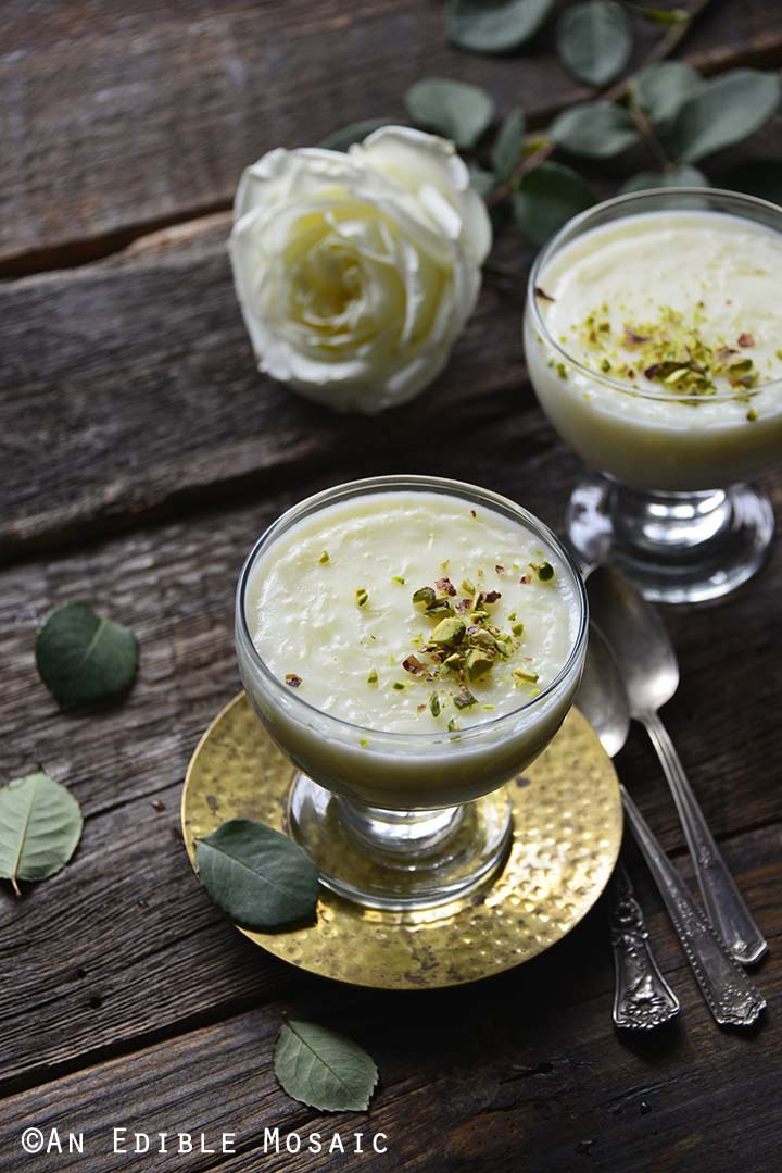 Rice Pudding in Glasses on Dark Table with White Roses