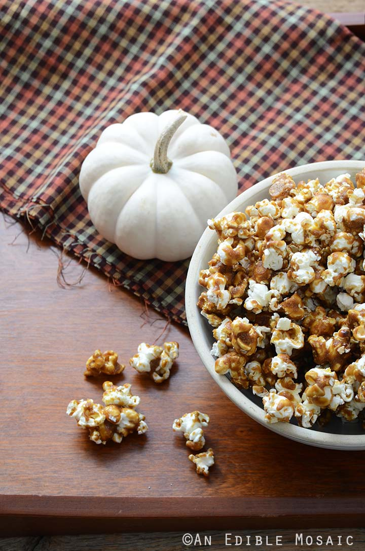 Butterbeer Popcorn with Small White Pumpkin on Wooden Table