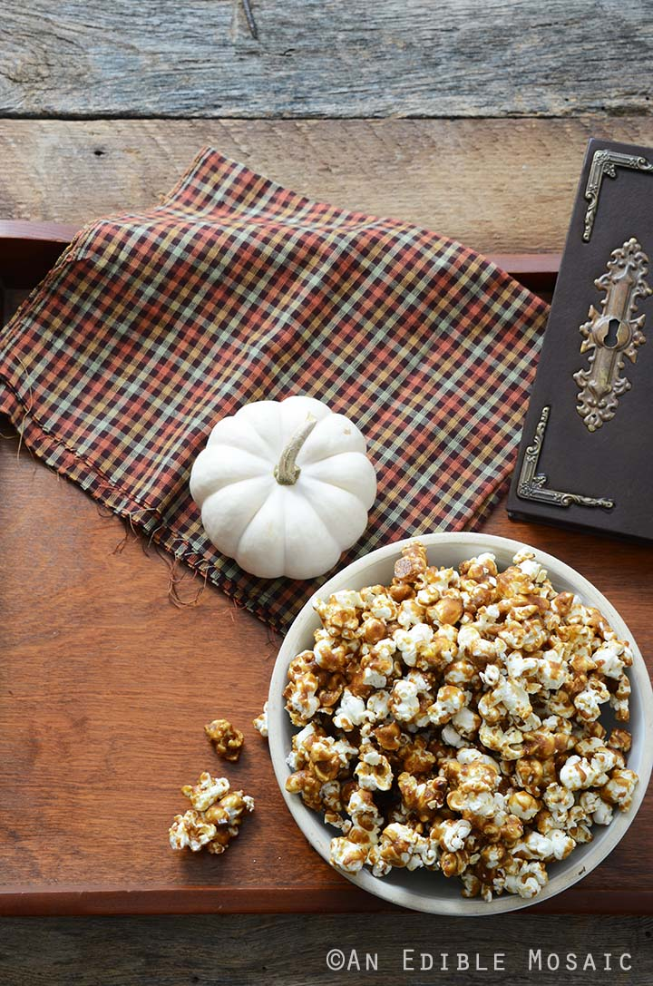 Butterbeer Popcorn Recipe on Wooden Table with Brown Checkered Linen and Old Book
