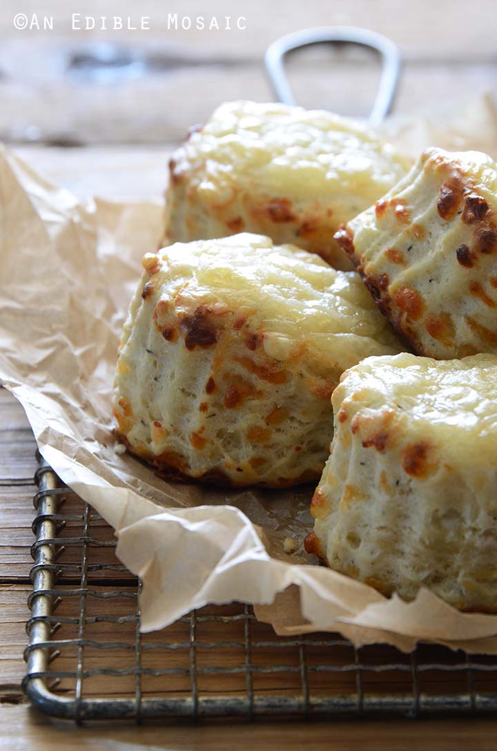 Close Up Front View of Cheese and Thyme Scones on Wooden Table