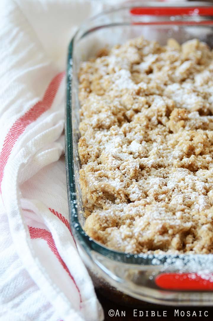 Pumpkin Crumb Cake in Glass Baking Pan with White Tea Towel