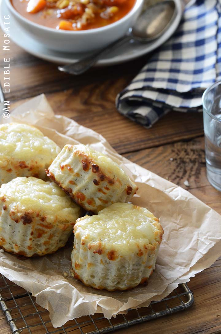 Swiss Cheese and Thyme Scones Recipe on Cutting Board with Bowl of Soup in Background