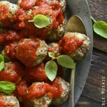 Beef Meatballs with Tomato Sauce on Metal Platter with Basil