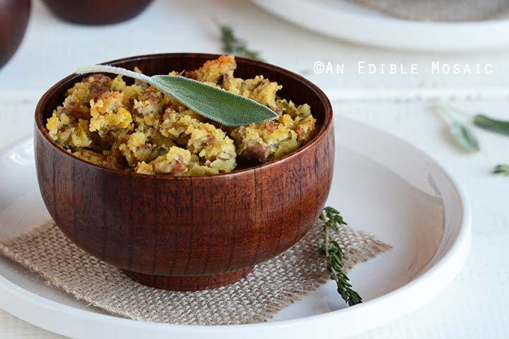 Cornbread Stuffing with Sausage Recipe in Dark Wood Bowl on White Table