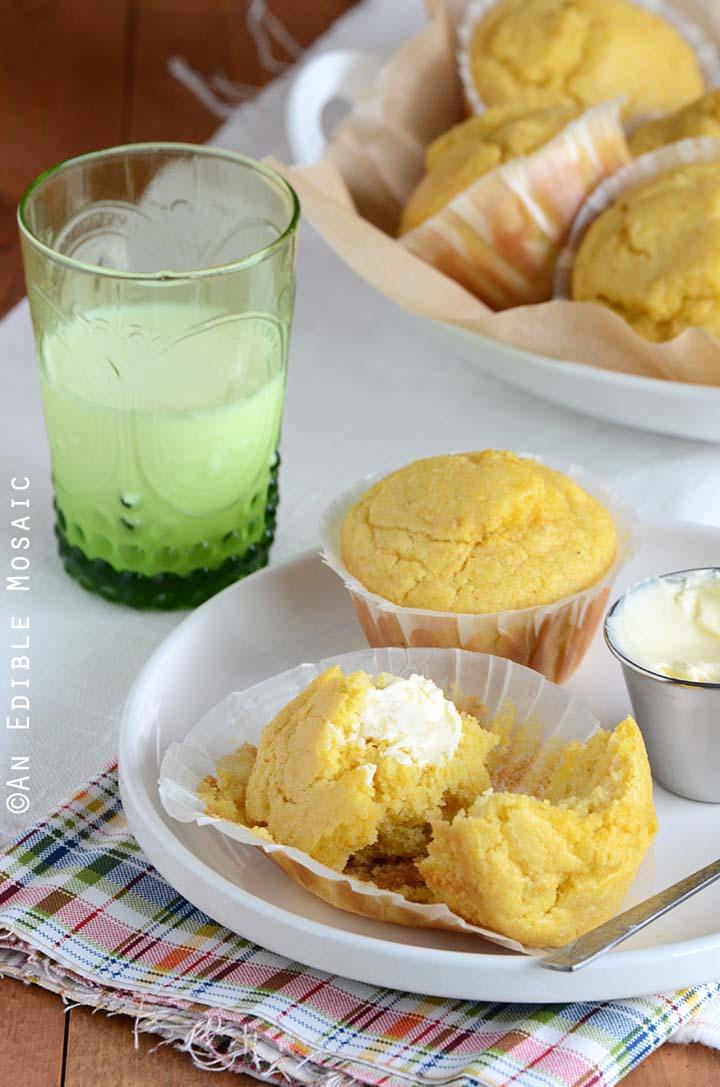 Buttered Cornbread Muffin Split in Half on White Plate