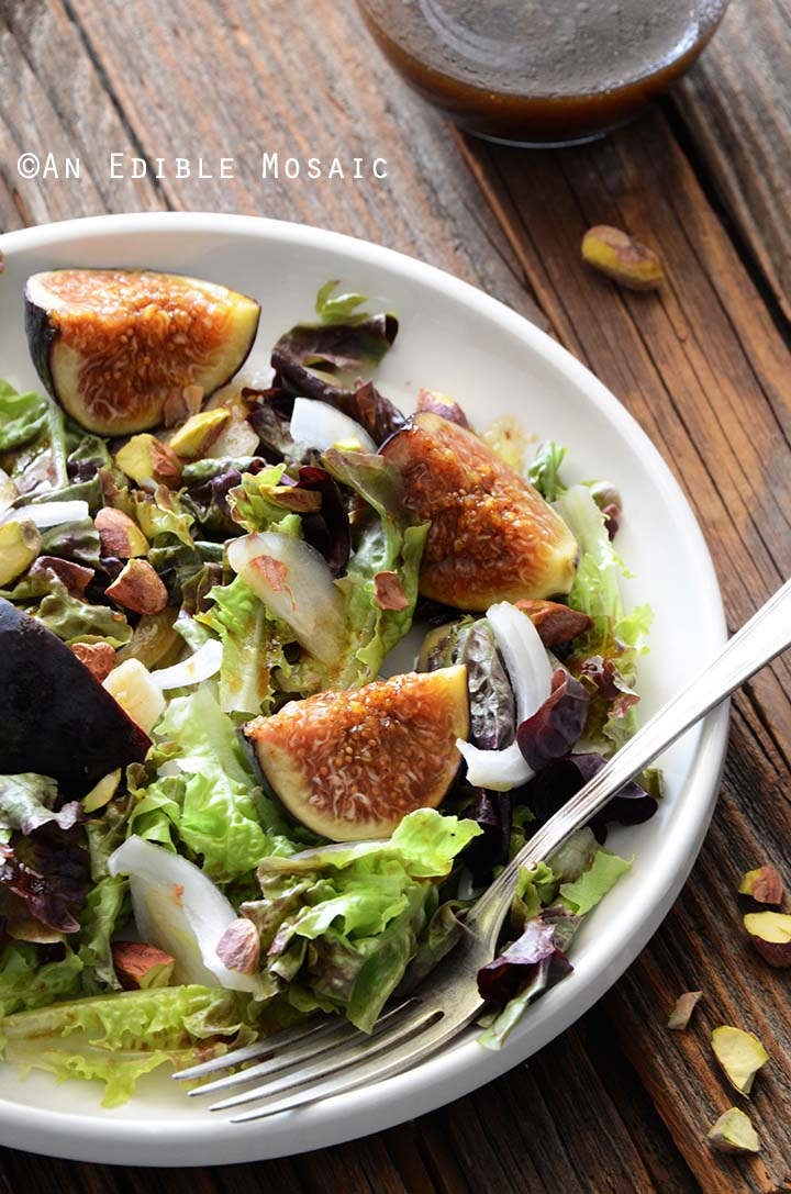 Close Up of Fig Salad with Fork on White Plate