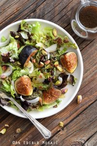 Top View of Fresh Fig Salad Recipe on White Plate on Wooden Table