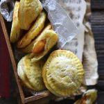 Peach Hand Pie Recipe in Wooden Box on Top of Vintage Music Sheets