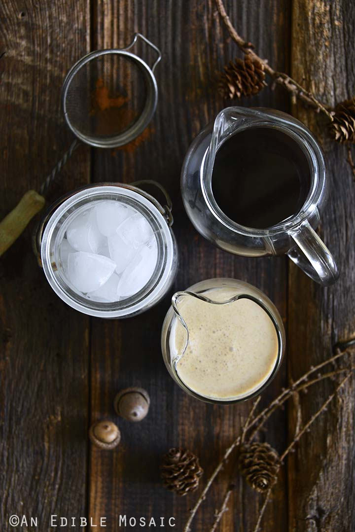 Components for Pumpkin Cream Cold Brew Arranged on Wooden Tabletop