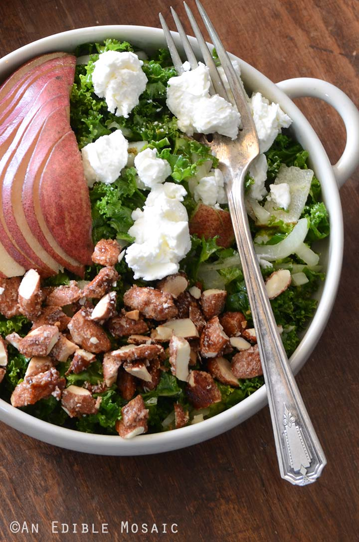 Close Up Top View of Pear Salad with Kale and Candied Almonds