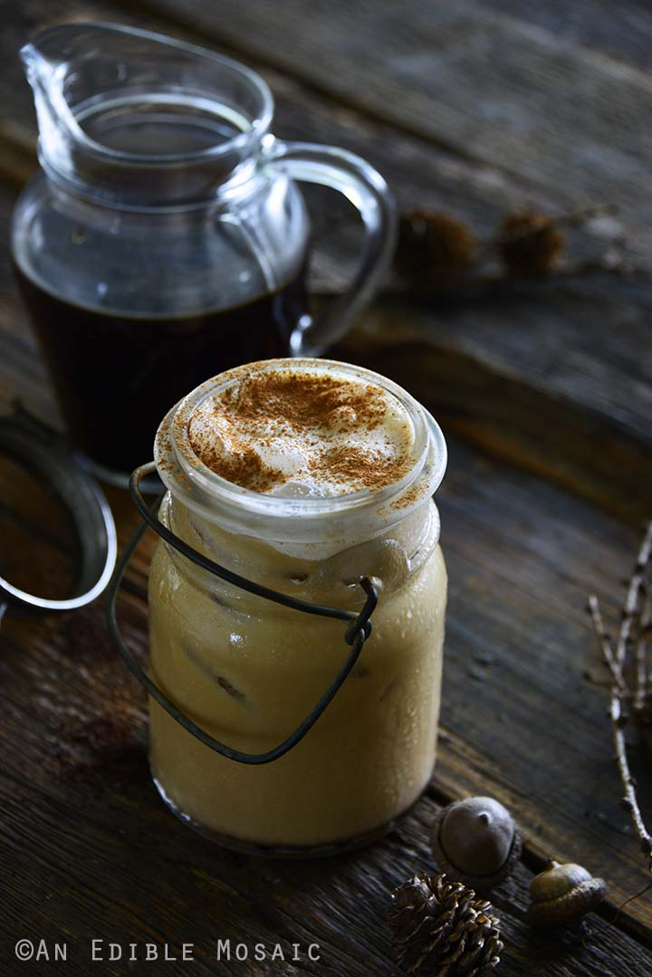Pumpkin Cream Cold Brew in Glass Mason Jar with Pitcher of Cold Brew Coffee