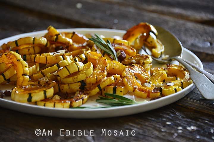 Roasted Delicata Squash on Serving Platter on Dark Wood Table