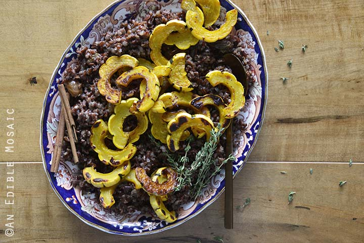 Close Up of Warm Red Rice Salad on Blue and Red Platter