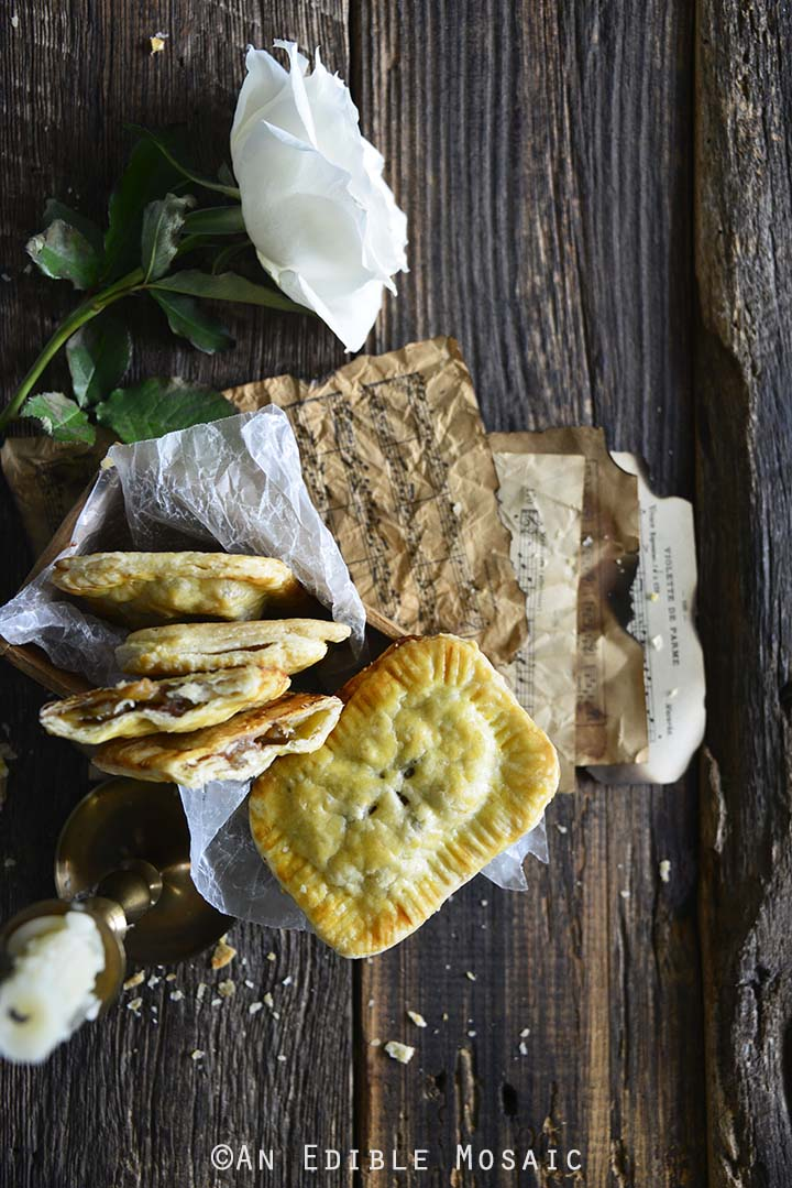 Apple Hand Pies with White Rose on Dark Wood Table